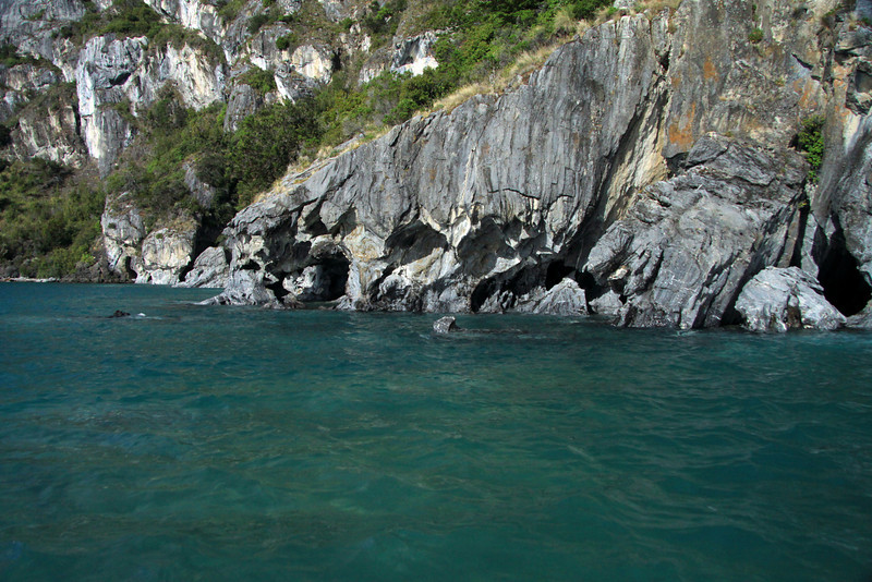 Water sculpted marble shoreline - along the glacial water and western shoreline, of Lago Carrera.