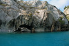 Water sculpted sea caves and sea stacks, along the metamorphic marble shoreline of Lago Carrera.