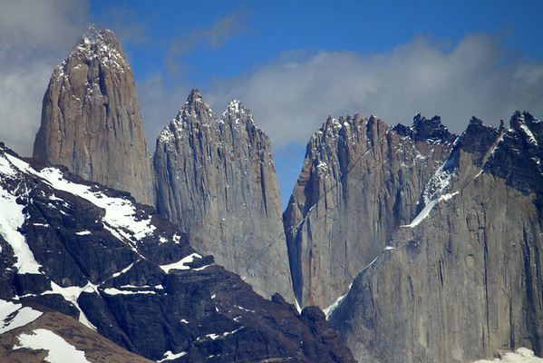 Beyond the northern slope of Mount Almirante Nieto - to the Torres Central and Norte, revealing solid intrusivise igneous granite spires and Cerro Nido Condor (r), showing a metamorphic hornsfel rock cap.