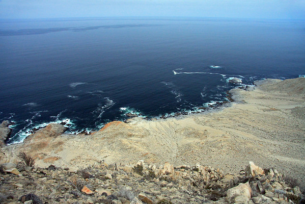 From the cliff along the Coastal Range, at about 1,040 ft. (317 m) - viewing westward down to the waves breaking upon the Atacama Desert coastline - Pan Azucar National Park - the beginning of the Grande Norte (natural region) of Chile, characterized by coastal cliffs and a desert climate.