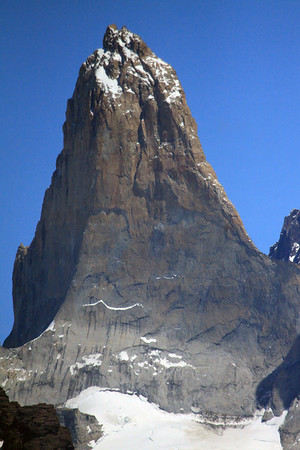 Torre Sur - rising to about 9,350 ft. (2,850 m) - and the glacier below - with a distal glimpse of Cerro Fortaleza, and foreground of Mt. Almirante Nieto.