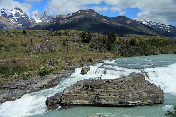 Cascada Rio del Paine - to the mostly cloud covered Torres del Paine - with Mt. Almirante Nieto (l) - and the Lenga Beech forest slope of Cerro Paine (r).