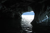From a metamorphic marble cave, displaying an overhang (l) and arch (r) - out onto the glare atop Lago Carrera.