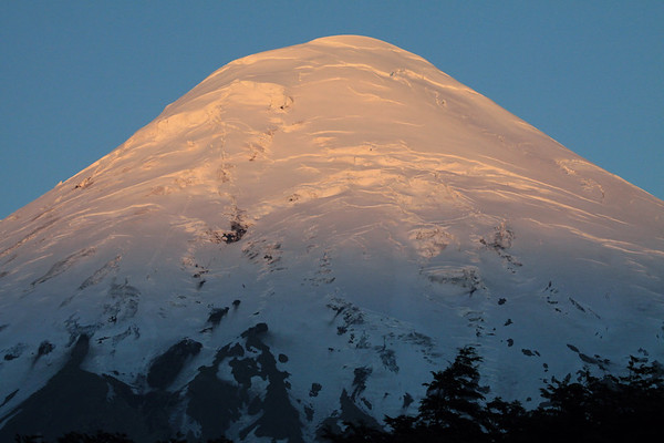 Morning light upon the glacial ice peak of Volcan Osorno.