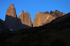 Across the slope of Cerro Paine - past the slope of Mt. Almirante Nieto (l) - to the shadowed and sunlit Torre Central and twin peaks of Cerro Norte - with Cerro Nido Condor adjacent - and the New Year's totally naked, Patagonia sky of Chile beyond.