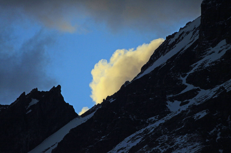 Beyond the eastern slope of Mt. Almirante Nieto - to the sunset light beaming upon a cumulus cloud.