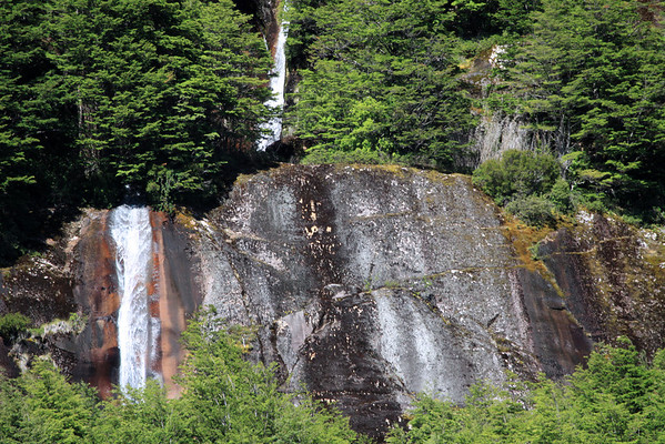 Couple of horsetail falls - upon the iron oxide rich rock, scattered with epiphytic lichen, and surrounded by southern beech trees.