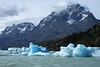 From the bergy bits to a blocky iceberg, along the southern end of Lago Grey - across the rocky and vegetated peninsula - to Punta Bariloche (r), the southern end of Cerro Paine Grande - and Cerro Catedral (l).