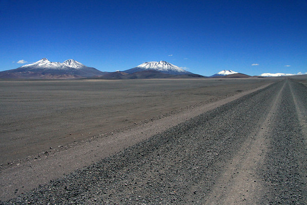 Along ruta C-31- to the two peaks (l) rising up to around 19,032 ft and 19,229 ft (5,801 m and 5861 m) - then Cerro Peña Blanca (c), peaking at around 19,783 ft  (6,030 m) - and beyond (r) to Cerro Laguna Verde, peaking at around 19,127 ft  (5,830 m) - all this peaks form the province border between here in Copiapó and northward into the Chañaral province - Atacama region - northern Chile.