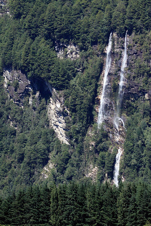 Dual Chute Waterfalls amongst the igneous rock slope, flowing into below the Rio Aysén, at its source the mouths of the Río Mañihuales and Río Simpson - eastern Aisén province - Aisén region.