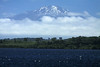 Volcan Calbuco, peaking at about 6,572 ft. (2,303 m) - located in the Llanquihue National Reserve - here displaying the snow-capped glacial ice, along the western face - from hre across the white-caps upon Lago Llanquihue - Los Lagos region.