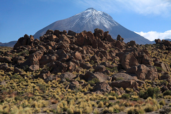 Beyond the volcanic rock, tussock grasses, and xeric shrubs - to Volcán Colorado, peaking at around 18,858 ft (5,748 m) - Loa province - northeastern Antofagasta region.