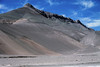 Up the steep slopes and ridge to the cliff ledge point rising up to around 5,217 ft (1,590 m) - northeastern Copiapó province - Atacama region.