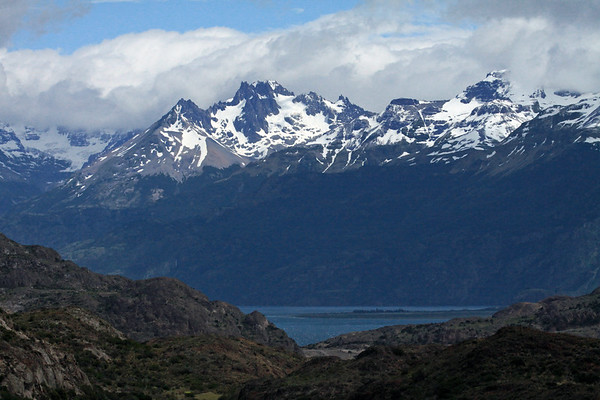 Sierra Avallanos, peaking at around 7,746 ft (2,361 m) - with below the mouth the Rio Avallanos flowing into Lake General Carrera - Aisén region.