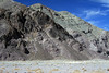 Quebrada Paipote - across the river bed,  to the igneous rock fractures and dykes amongst the sedimentary rock strata - northeastern Copiapó province - Atacama region.