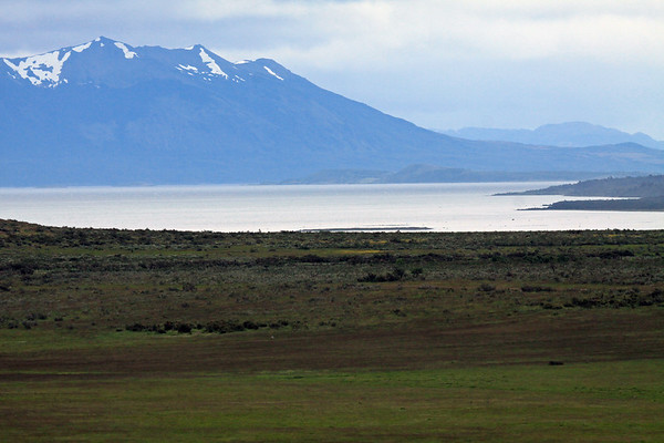 Across the Gulf of Admiral Montt - from the far southern shoreline points upon the Antonio Vargas Peninsula - to Isla Focus - then above the snow patches along the slopes upon the Barros Arana Peninsula - southern Última Esperanza province, in the east-central Magallanes region.
