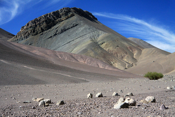Fallen tallus boulders amongst the mineral rich slopes along the Quebrada Paipote, with the cirrus clouds above - along route C-601, towards the Porteuelo Maricunga pass, at about 13,615 ft. (4,150 m) - northern Copiapó province - Atacama region.