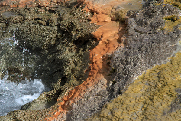 Colorful deposits of precipitated mineral pigments, amongst the erupting geothermal hot spring - Tatio Geyser Field - Loa province - northeastern Antofagasta region.