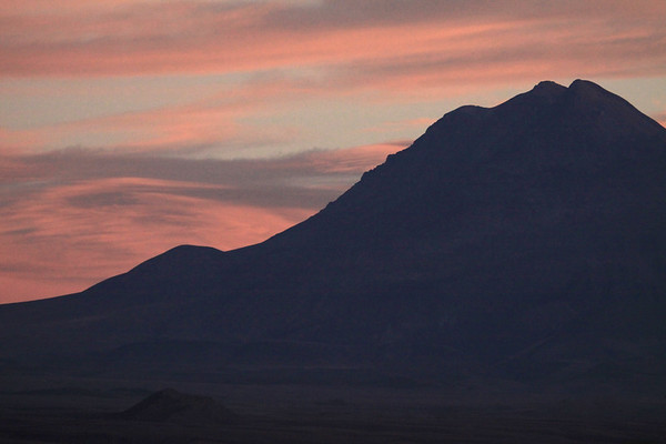 Post sunset upon the silhouette of Volcán Tumisa - Loa province - eastern Antofagasta region.