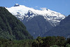 Snow-capped glacier at the head of the Aisén Fjord, amongst the many waterfalls during the early-summer season - from here along the forested slope northward from Puerto Chacabuco - eastern Aisén province - Aisén region.