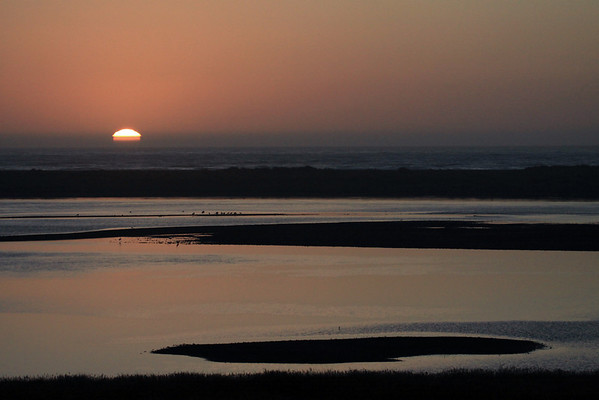 Sunset reflection upon the horizon of the Pacific Ocean - from here at the mouth of the Río Cucao, along the western coastline of Isla Chiloé, amongst the aves - Los Lagos region.