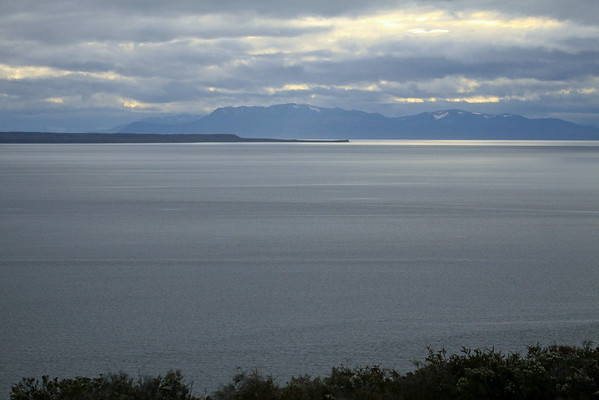 Across the Bahia Inutil - to the northern tip of Isla Dawson, at Cabo Valentin - then across the Strait of Magellan to Isla, to the eastern snow-patched slopes of the Brunswick Peninsula (the southern-most mainland landmass of Chile).