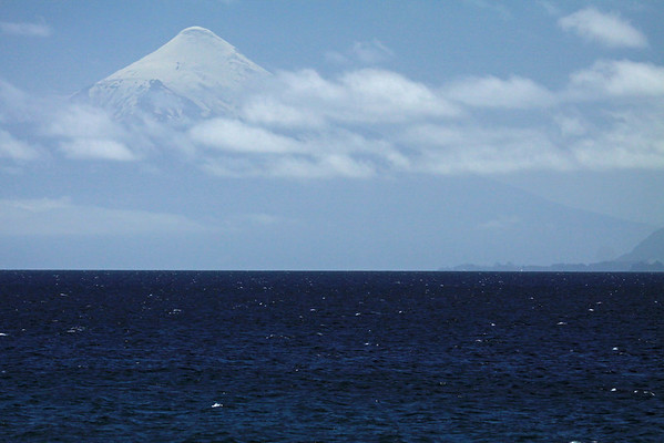 Volcan Osorno, rising to about 8,730 ft. (2,661 m) in the Vicente Perez Rosales National Park (1926) - adjacent Lake Llanquihue - Los Lagos region.