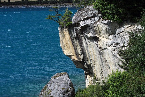 Fallen boulder along the rock cliff face - with below the glacial water upon the northwestern arm of Lago General Carrera - Aisén region.