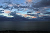 Sunset illumination upon the cumulus and stratocumulus clouds above the Strait of Magellan and Brunswick Peninsula, from the Grand Island of the Land of Fire.