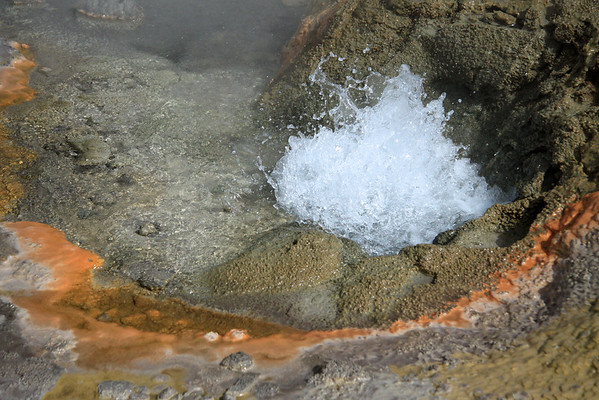 Tatio Geyser Field - erupting geothermal hot spring amongst the colorful deposits of precipitated mineral pigments - Loa province - northeastern Antofagasta region.