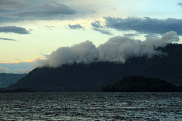 Cloud-bank along the forested slope of Lago Calafquen - Araucania region.