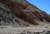 Fallen boulders along the valley floor with the colorful eroded slopes above - central Chañaral province - Atacama region.