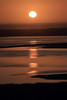 Sunset reflection along the western shoreline upon Chiloé Island - at the mouth of the Río Cucao into the Pacific Ocean coastline, amongst the aves - Los Lagos Region.