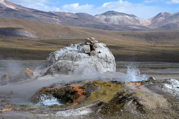 Tatio Geyser Field - erupting hot spring vents amongst the colorful deposits of precipitated mineral pigments - Loa province - northeastern Antofagasta region.