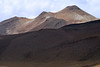 Sunlight and cloud-shadow upon Volcán Tatio - Loa province - northeastern Antofagasta region.
