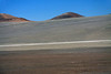 Atacama Desert - stretches southward for about 600 mi. (1,000 km), from the northern Chile border, and is only around 110 mi. (180 km) at its widest, and extends from the Pacific Coast up to about 4,900 ft. (1500 m), this is the driest (non-polar) desert on Earth - here amongst the volcanic rock outcrops along the Cordillera Costa (Coast Range) - in the southwestern Antofagasta region - northern Chile.