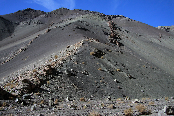 Igneous rock dykes amongst the talus boulders, along the steep slope of the Quebrada Paipote - northern Copiapó province - Atacama region.