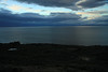 Across the Bahia Inutil, southward to the sunrise glow upon the clouds above Isla Grande de Tierra del Fuego.