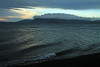 Waves breaking along the north-eastern shore of Lago Calafquen - with the sunset and cloud-bank along the distal horizon.
