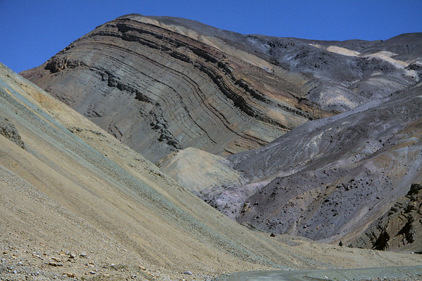 Folded rock slope amongst the colorful array of mineral pigments - central Chañaral province - Atacama region.