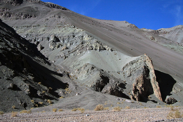 Igneous rock dyke along the base of the steep slope, adjacent the river bed in the Quebrada Paipote - northern Copiapó province - Atacama region.