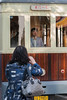 A woman quickly snaps a picture as the tourist trolley heads back up Qianmen (Xicheng, Beijing, CN - 10/23/13, 3:27:30 PM)
