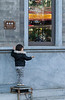 A child plays outside an antique shop on Qianmen Dajie (Xicheng, Beijing, CN - 10/23/13, 3:28:56 PM)
