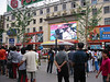 Crowds gather to watch a soccer match on Wangfujing Dajie.