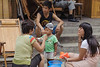 A child is fed noodles on a Luoyang sidewalk. (Laocheng, Luoyang, Henan, CN - 07/14/11, 1:10:36 PM)