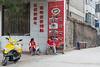 Retaurant employees enjoying a break. (Yuanqu, Yuncheng, Shanxi, CN - 07/21/12, 1:37:05 PM)