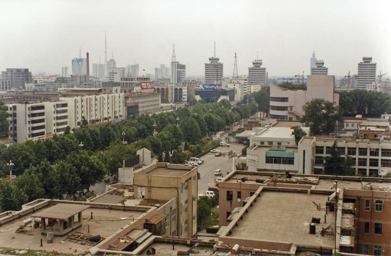 Looking West toward the Anyang Train Station area. This photo is mapped and the marker is placed on the tree-lined road at the left-center of the frame.