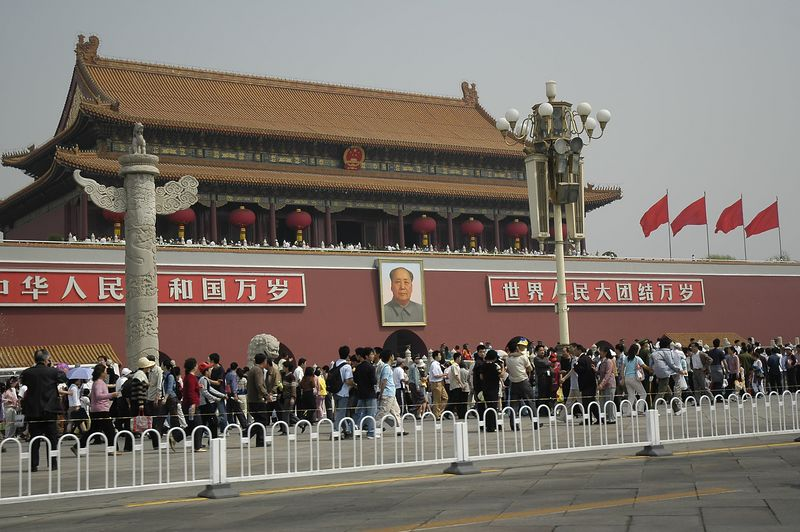 One of the most well known Chinese icons, Tiananmen, or Heavenly Peace Gate, is the south entrance to the Forbidden City. Chairman Mao watches over the crowds in Tiananmen Square across the street - Beijing, P.R.C.