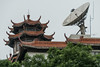A satellite dish in an interesting juxtaposition with a modern sylized traditional Chinese tiled-roof. (Dongcheng Qu, Beijing Shi, CN - 08/13/06, 2:00:55 PM)