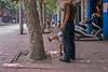 Daddy makes a call while Junior makes a pee. (Yanshi Shi, Luoyang Shi, Henan Sheng, CN - 08/16/06, 12:58:46 PM)